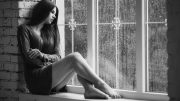 beautiful-young-woman-sitting-alone-close-to-window-rain-drops-sexy-sad-girl-concept-loneliness-black-near-long-slim-66485280